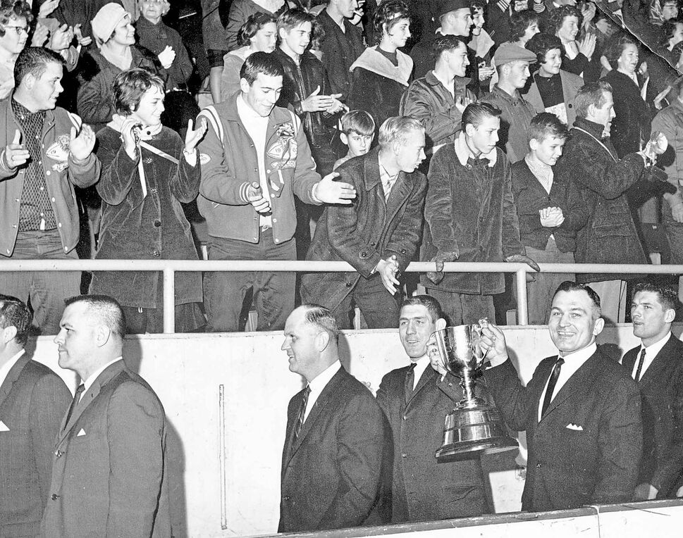 Herb Gray (holding cup, on left) and Steve Patrick from the winning 1962 team. (WINNIPEG FREE PRESS ARCHIVES)