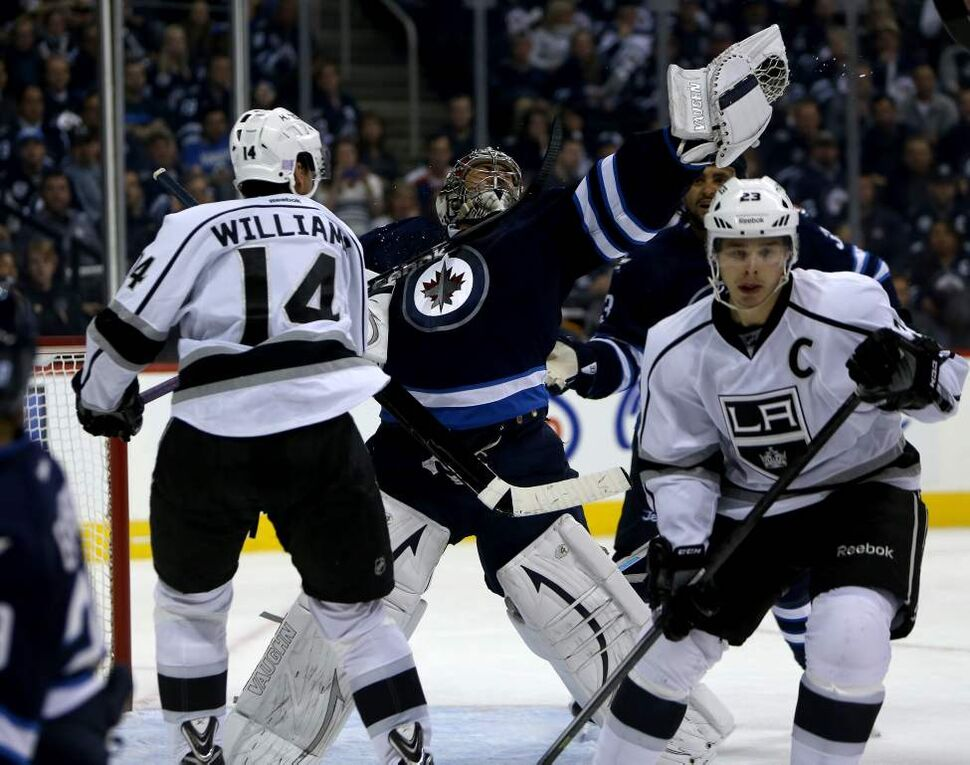 Los Angeles Kings' Justin Williams (14) hits Winnipeg Jets' goaltender Ondrej Pavelec (31) with his stick as they both reach for a puck during the third period. (TREVOR HAGAN / WINNIPEG FREE PRESS)