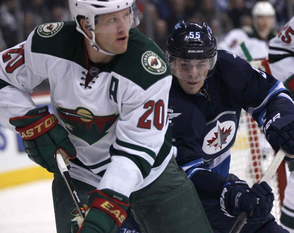 Winnipeg Jets forward Mark Sheifele (right) keeps his eye on the Minnesota Wild defenceman Ryan Suter during the second period. (JOE BRYKSA / WINNIPEG FREE PRESS)