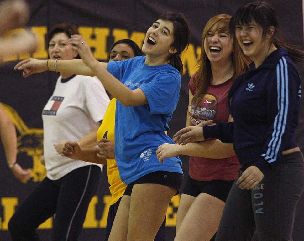 Fort Richmond High School students laugh during the winter school assembly with 140 students and staff taking part in the 45-minute Zumba Dance workout.  January 11,  2011
