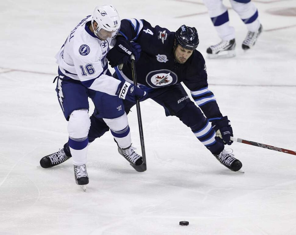 Tampa Bay Lightning's Teddy Purcell (16) battles with Winnipeg Jets' Zach Bogosian (4) during first period NHL action at MTS Centre in Winnipeg, Saturday, April 7, 2012. (TREVOR HAGAN/WINNIPEG FREE PRESS)