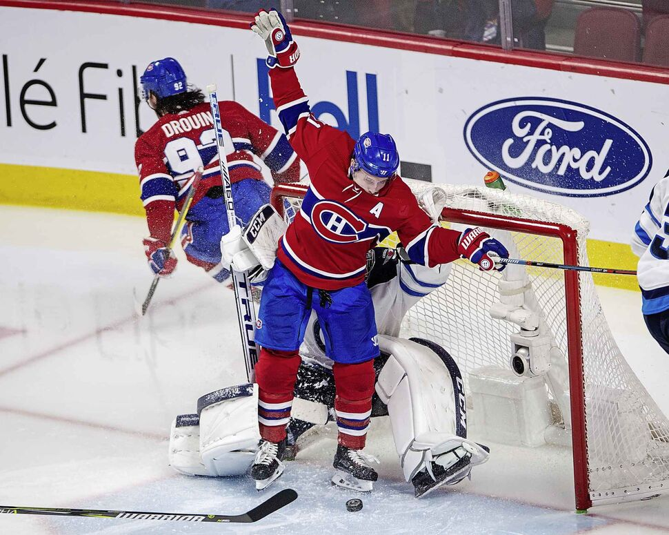 Montreal Canadiens right wing Brendan Gallagher celebrates Montreal Canadiens goal on Winnipeg Jets goaltender Connor Hellebuyck Thursday, in Montreal.