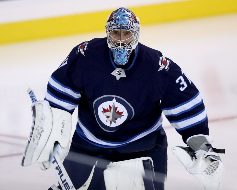 Winnipeg Jets' goaltender Connor Hellebuyck. (CP)
