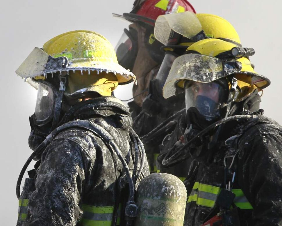 Winnipeg firefighters at the scene of a bungalow fire in the 300 block of Magnus Avenue Friday morning. The two adult male occupants were out of the house uninjured when fire fighters arrived. January 12, 2012 (WAYNE GLOWACKI/WINNIPEG FREE PRESS)