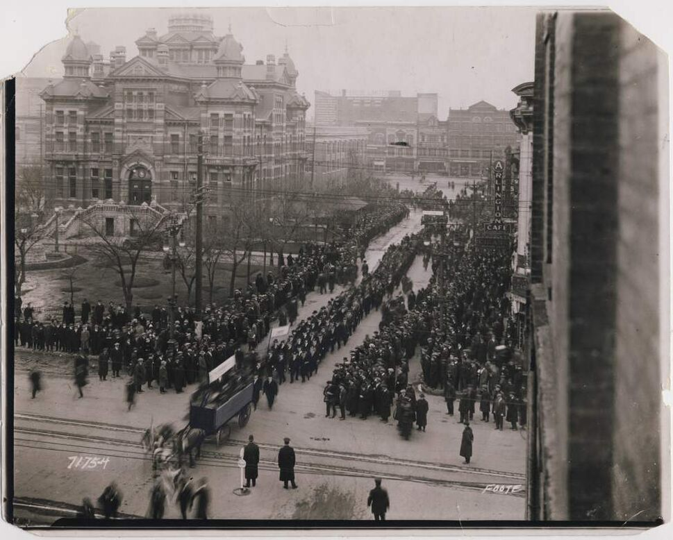 City Hall, April 4 (or 2), 1921 NOTE: In the paper on Monday, April 4, 1921, a story on page 15 with the headline: Unemployed March In Parade Through City — Union Jack At Head and Socialist Red Flag Midway Winnipeg Free Press Archives