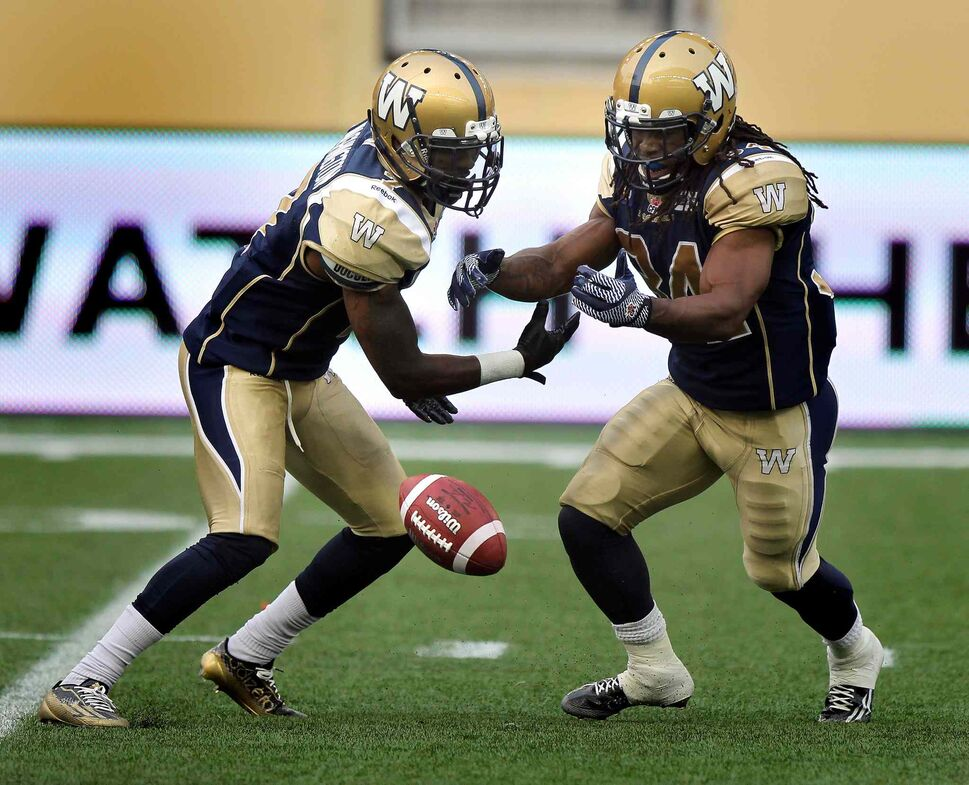 Winnipeg Blue Bombers' running back Nic Grigsby, left, and #34 Paris Cotton bobble a kick from the Edmonton Eskimos deep in the Bombers' zone during Thursday's game. (Phil Hossack / Winnipeg Free Press)