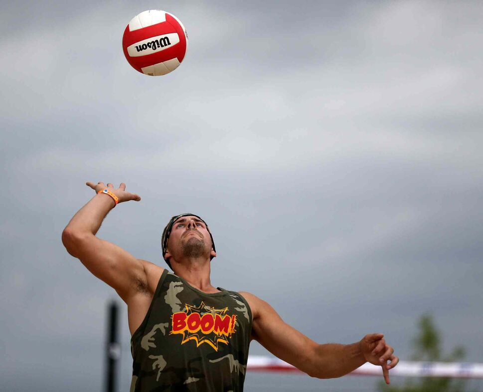 Brian Sterzer of team Boom! serves the bal during the Super-Spike volleyball tournament at Maple Grove Rugby Park, Friday, July 18, 2014.  (TREVOR HAGAN/WINNIPEG FREE PRESS)