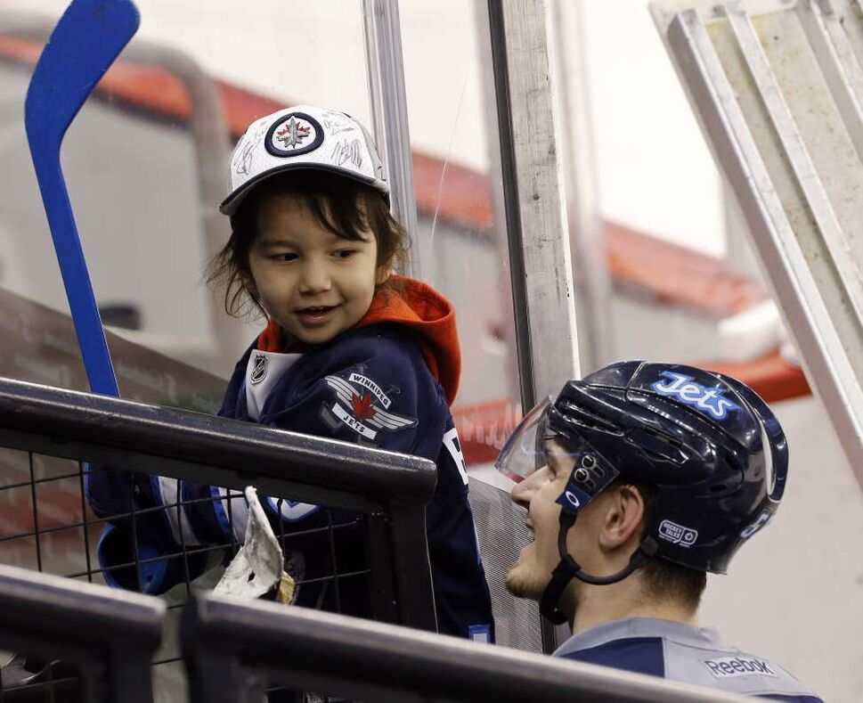 Hard to tell who is more thrilled. Jets'  Mark Scheifele  signs jersey  and stick of a thrilled Jace Ryder, 3,  at the Jets game-day skate. Jace  is visiting with his family from Saskatoon and were able to watch the  team prepare for their game with the Nashville Predators.  January 28, 2014 (KEN GIGLIOTTI / WINNIPEG FREE PRESS)
