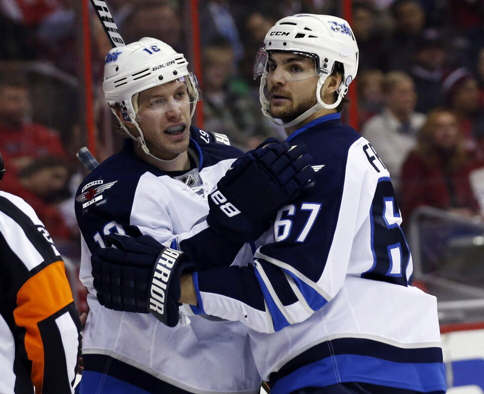 Winnipeg Jets' centre Bryan Little (18) celebrates his goal with right wing Michael Frolik (67), during the first period of Thursday's game against the Washington Capitals. (Alex Brandon / The Associated Press)