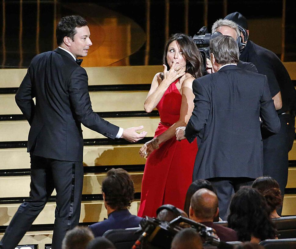 Jimmy Fallon interrupts Julia Louis-Dreyfus during a kiss from Bryan Cranston. (Tribune Media MCT)