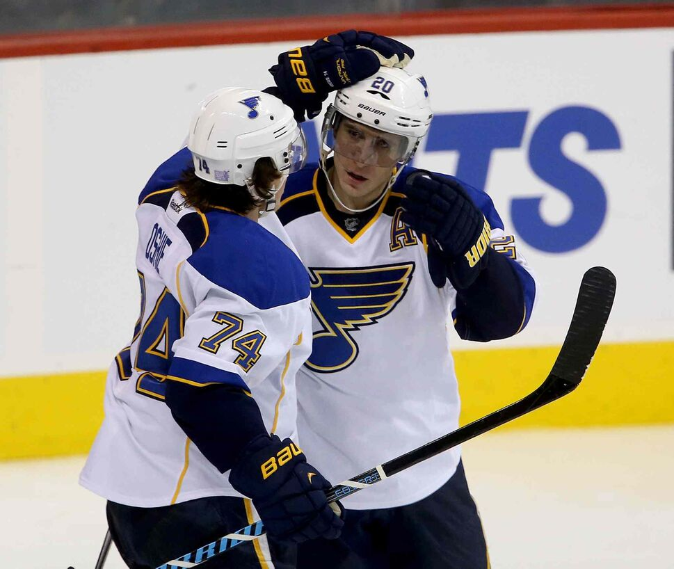 St. Louis Blues' T.J. Oshie (left) and Alexander Steen celebrate after Steen's second goal of the game in the third period. (TREVOR HAGAN / WINNIPEG FREE PRESS)