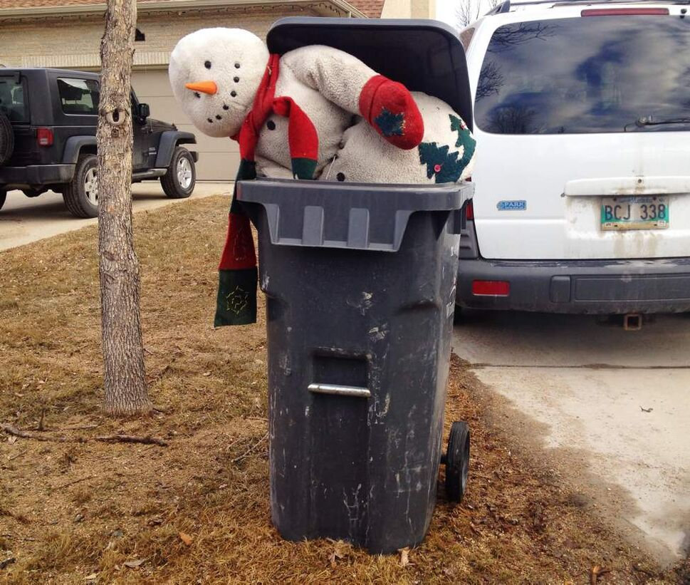 Old frosty the snowman gets put out with the trash on Shamrock Drive in south east Winnipeg.  April 22, 2014