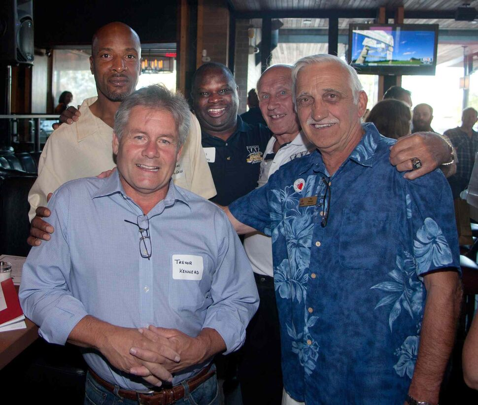 Winnipeg Blue Bombers past and present came out to support Variety, the Children's Charity of Manitoba, at Earls St. Vital on Aug. 25, 2015. The Hearts of Blue and Gold fundraising dinners are held twice a year. Pictured (back row, from left) are Lamar McGriggs, James Murphy and Nick Miller, and Trevor Kennerd (front row, from left) and Roy Rozmus of Variety.  (JOHN JOHNSTON / WINNIPEG FREE PRESS)