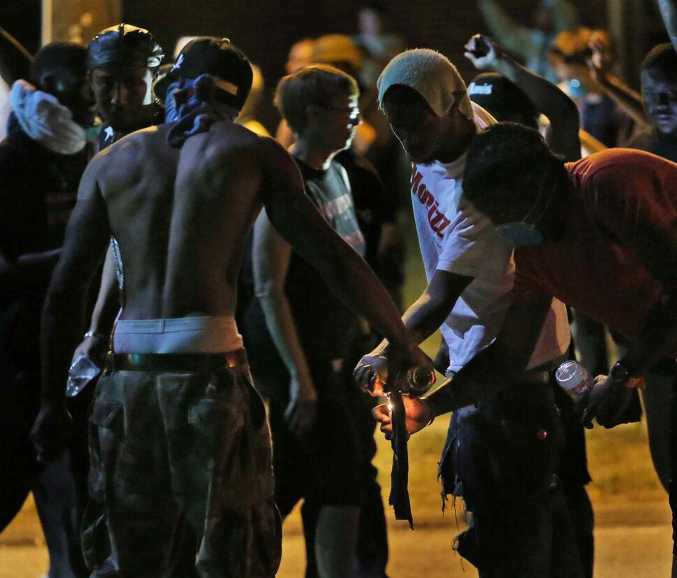 Protesters try unsuccessfully to light a Molotov cocktail Wednesday. (Chris Lee / St. Louis Post-Dispatch)