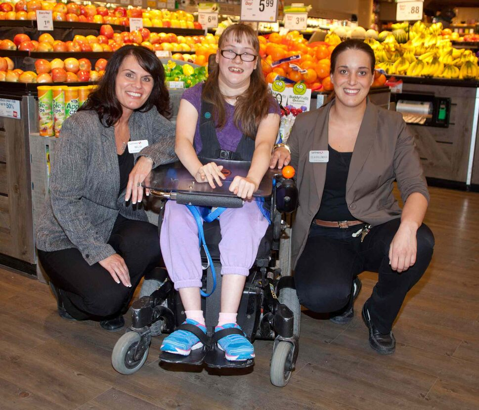 Safeway kicked off its annual fundraising effort for Easter Seals at its south Osborne Street store this week. The campaign goes from June 12 through June 28, 2015. Pictured, from left, are Nelia Benevides (assistant store manager), Allie Onslow (SMD ambassador) and Celia Bollenbach (store manager).  (JOHN JOHNSTON FOR THE WINNIPEG FREE PRESS)