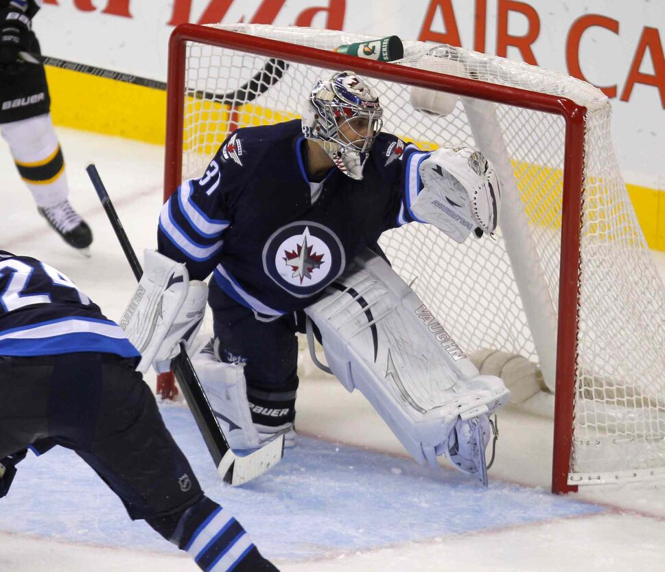 Ondrej Pavelec tracks a puck during the second period. (BORIS MINKEVICH / WINNIPEG FREE PRESS)