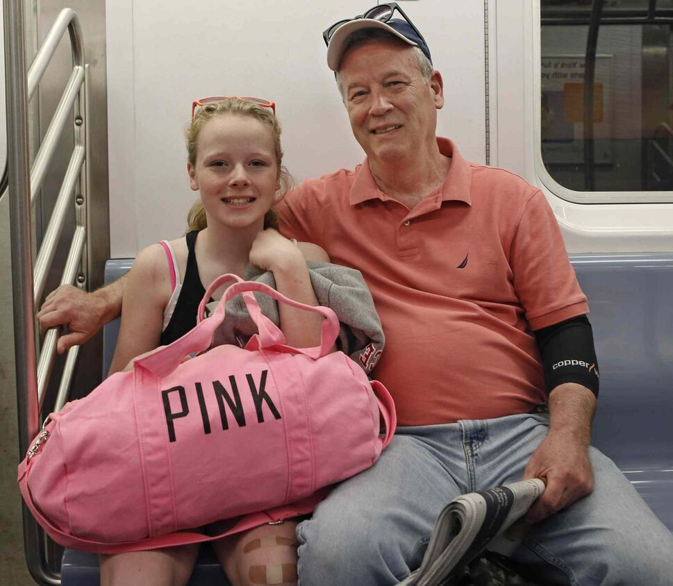 """Jim Leonard, 61, of Canton, N.Y., rides the subway with his daughter Riley, 12, after visiting his older daughter and her newborn in New York. """"My children are my greatest achievement,"""" he said. """"To see how they have grown, matured and become good, decent and loving people absolutely warms my heart """"The older you get, the more you appreciate it. When you're younger, you're so busy with everything, you don't have time to appreciate it."""" (Kathy Willens / The Associated Press)"""