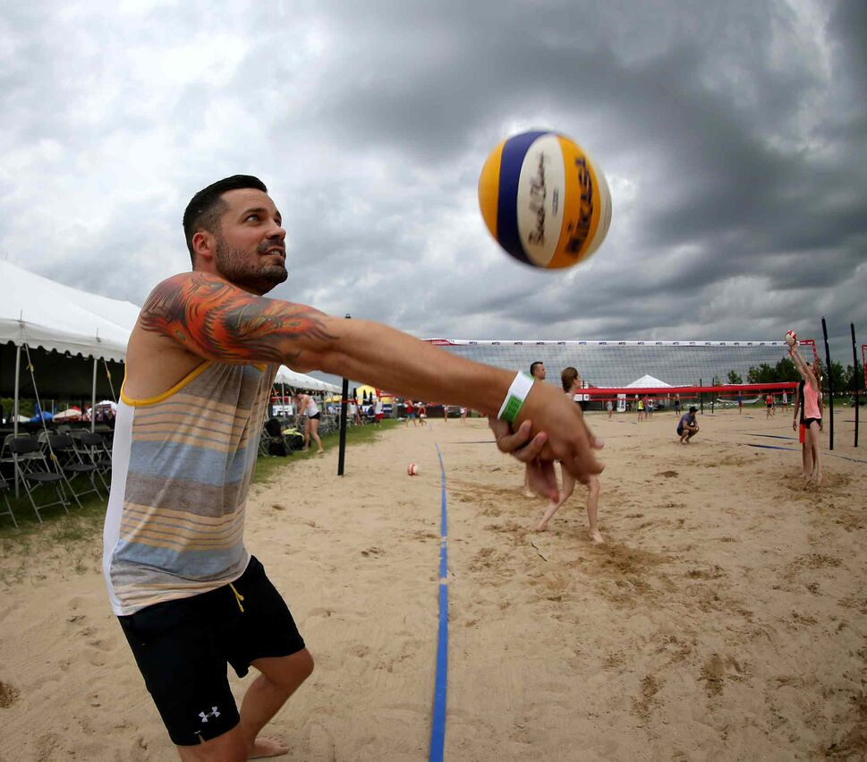 Marcus Gallant of City Kitties warms up at the Super-Spike volleyball tournament at Maple Grove Rugby Park, Friday, July 18, 2014.  (TREVOR HAGAN/WINNIPEG FREE PRESS)