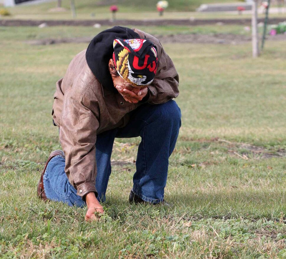 Oct. 2, 2013: Faron Hall gets emotional at his uncle Wilson grave #345 in Brookside Cemetery. Because no family was located when he died he was buried in a numbered grave plot. Faron was in jail when he passed away (JOE BRYKSA / WINNIPEG FREE PRESS Files)