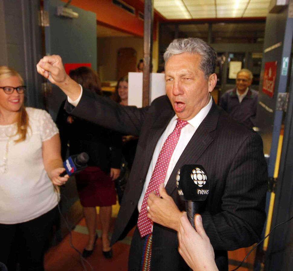 Liberal Dan Vandal party at the Franco-Manitoban Cultural Centre. Here he arrives to a cheering crowd.  (BORIS MINKEVICH / WINNIPEG FREE PRESS)