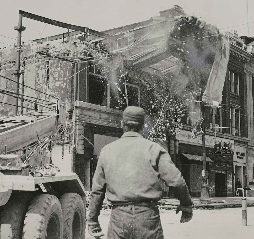 WINNIPEG FREE PRESS FILES</p><p>The front wall of the Edwards Block is sent crashing to the ground as three crane trucks with steel cables tug at its girders. As the building fell, the road shuddered under the impact.</p>