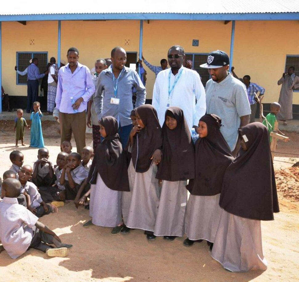 Muuxi Adam (in cap) with children in Humankind Academy uniform with UNHCR's head of operations Ahmed Warsame (white shirt), the Winnipegger who runs the world's largest refugee camp in Dadaab, Kenya.