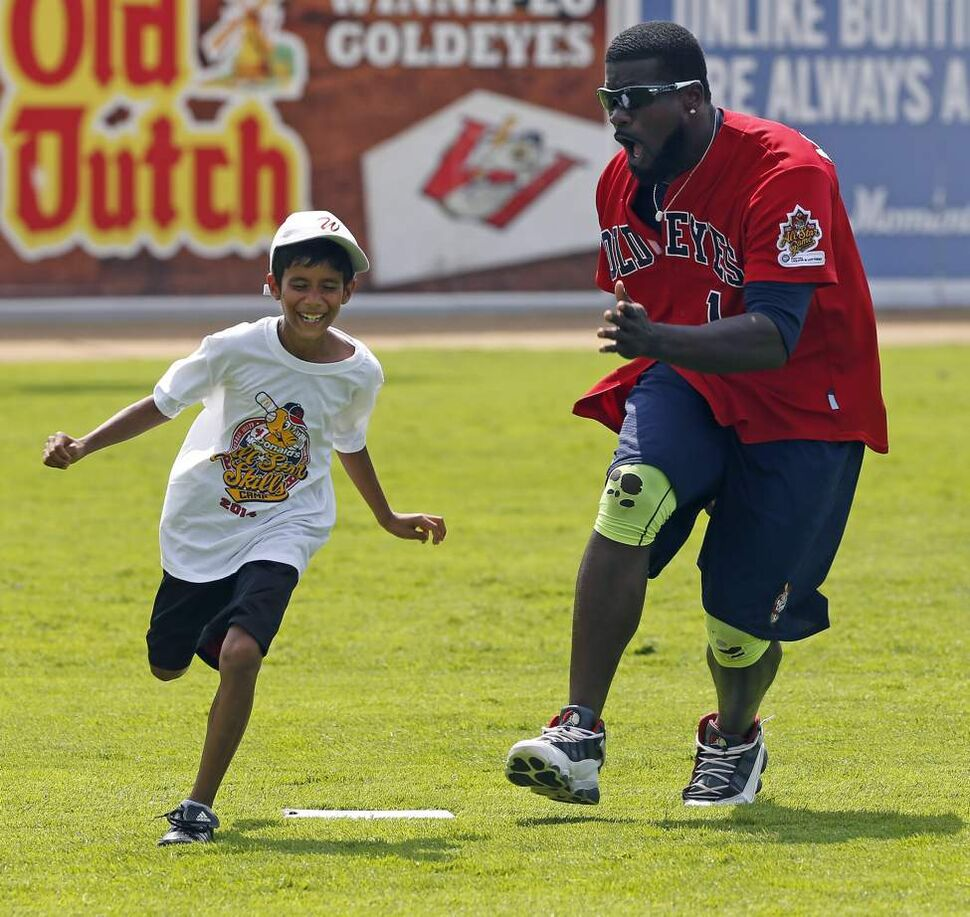 Fun and Run. Winnipeg Goldeyes outfielder #1 Reggie Abercrombie  chases Luke D'Souza  around third base during a base-running drill  at the  McDonald's All-Star Skills Camp at Shaw Park. July 29, 2014 (KEN GIGLIOTTI / WINNIPEG FREE PRESS)