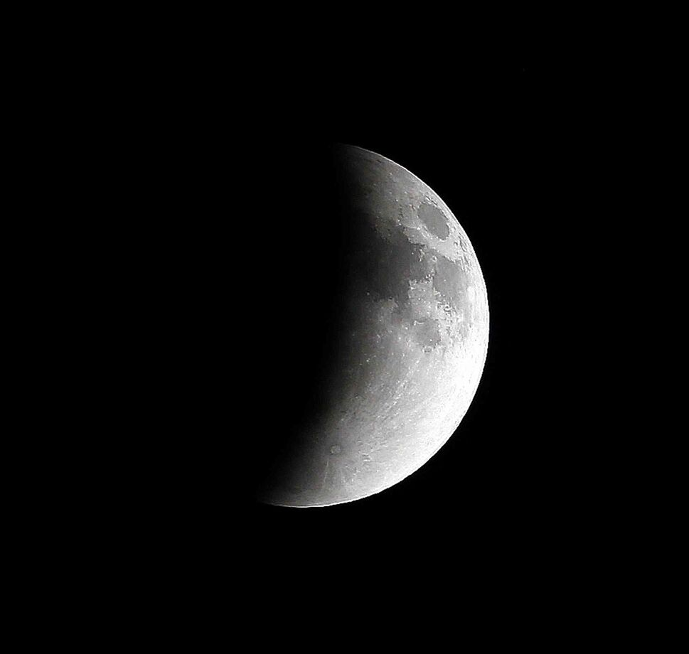 The moon was eclipsed by the Earth's shadow early Tuesday, beginning around midnight for 5-1/2 hours.  (Trevor Hagan / Winnipeg Free Press)