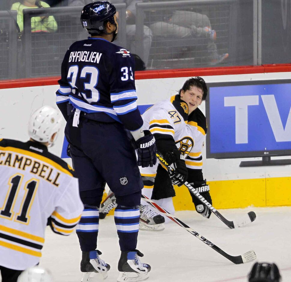 Dustin Byfuglien reacts after receiving a penalty for crushing Torey Krug. (BORIS MINKEVICH / WINNIPEG FREE PRESS)