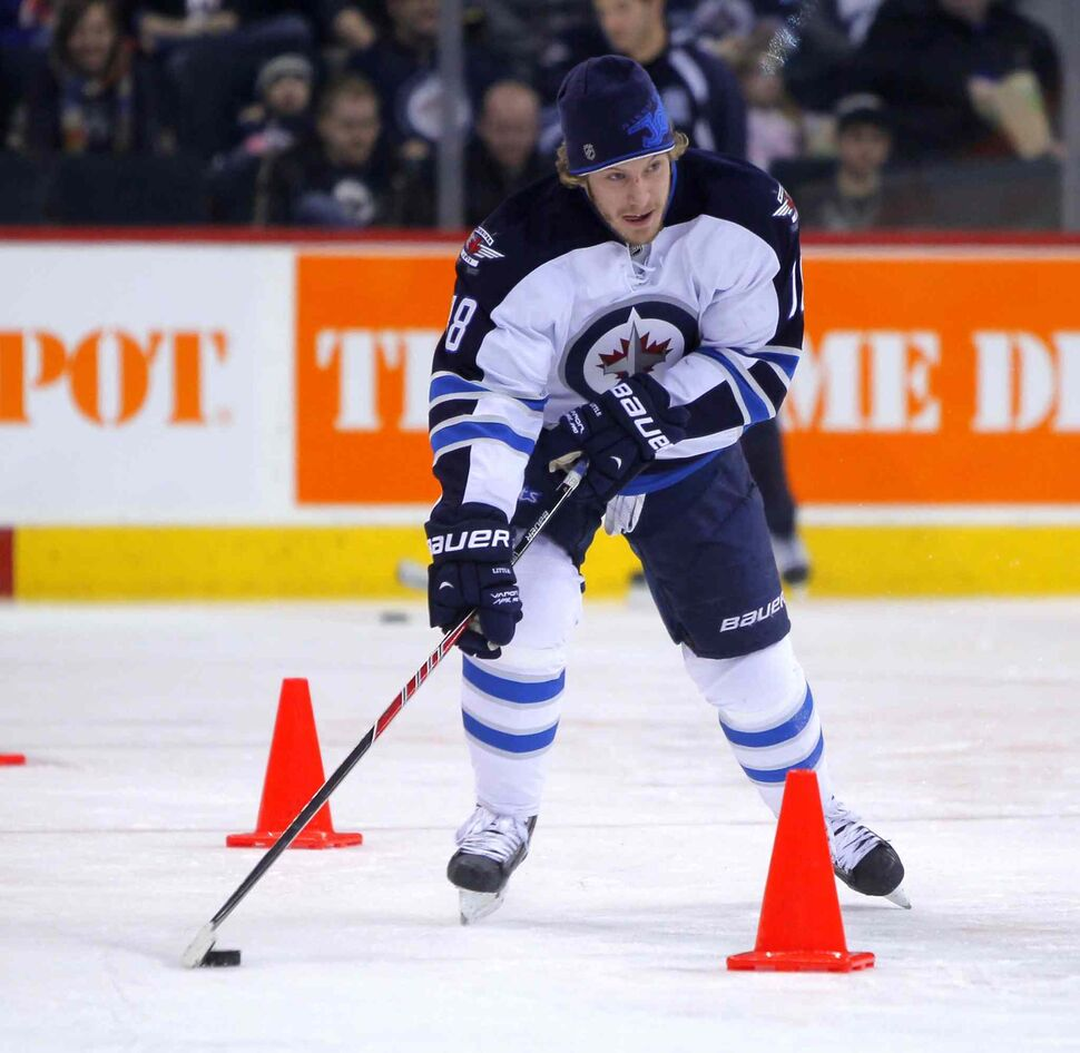 Bryan Little moves a puck between cones during the puck control relay portion of the skills competition. (Boris Minkevich / Winnipeg Free Press)