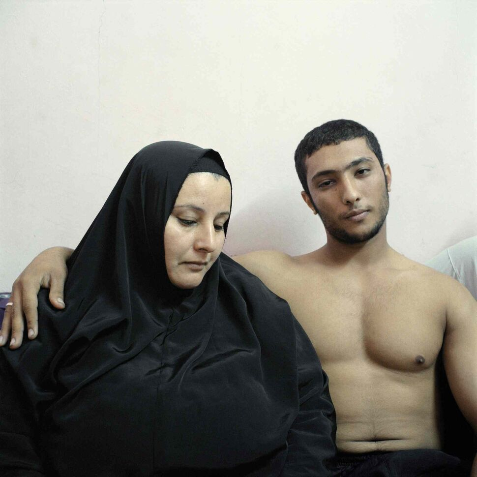 Second prize in the People Staged Portraits Stories category by Denis Dailleux of France<p> Ali, a young Egyptian bodybuilder, poses with his mother in Cairo, Egypt on Feb. 3, 2011.  (Denis Dailleux, Agence Vu)