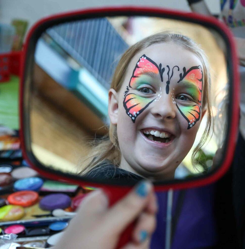 Kayla Landry, 10, loves butterfly face painting that she received at the 14th annual Festival of Fools. (Crystal Schick / Winnipeg Free Press)