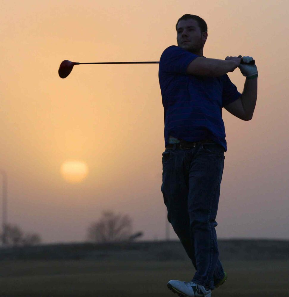 Spring found in Sioux Falls, South Dakota! Michael Thompson, enjoys 15 C weather at the Prairie Green Golf Course Wednesday evening in a t-shirt at the driving range.