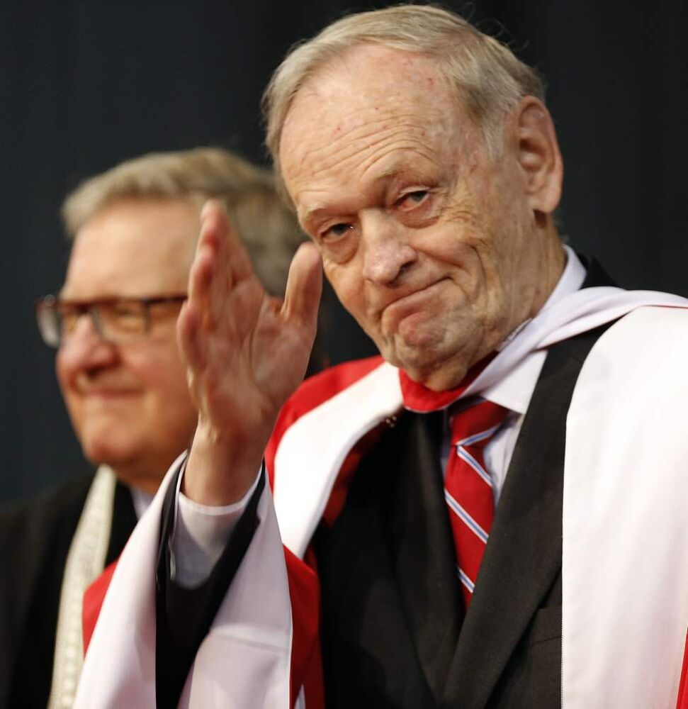 Former Prime Minister Jean Chretien waves to crowd after being honoured with a degree at 103rd University of Winnipeg convocation. June 12, 2014 (KEN GIGLIOTTI / WINNIPEG FREE PRESS)