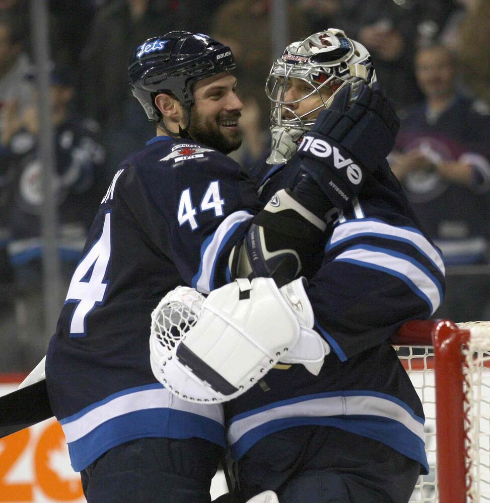 Winnipeg Jets goaltender Ondej Pavelec is congratulated by teammate Zach Bogosian after shutting out the Nashville Predators.