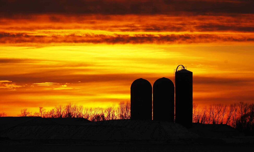 The sun sets behind a Manitoba farm on Highway 210, just east of St. Adolphe, Sunday, November 24, 2013.