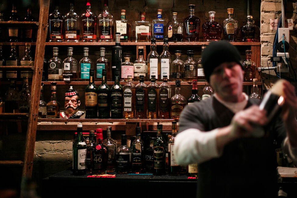 A section of the wall of whiskey at the Toad Whiskey Bar as Kevin makes a drink. Day 23. (MELISSA TAIT / WINNIPEG FREE PRESS)