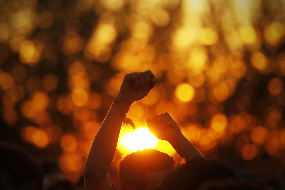 The sun sets over the closing day of the Winnipeg Folk Festival Sunday, July 14, 2013. 