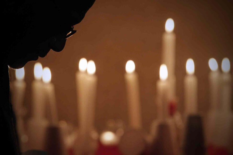 A man lowers his head during a candlelight vigil against tragic events taking place in Saudi Arabia to Ethiopian people, including torturing children, at the Ethiopian Society of Winnipeg, Sunday, December 1, 2013.