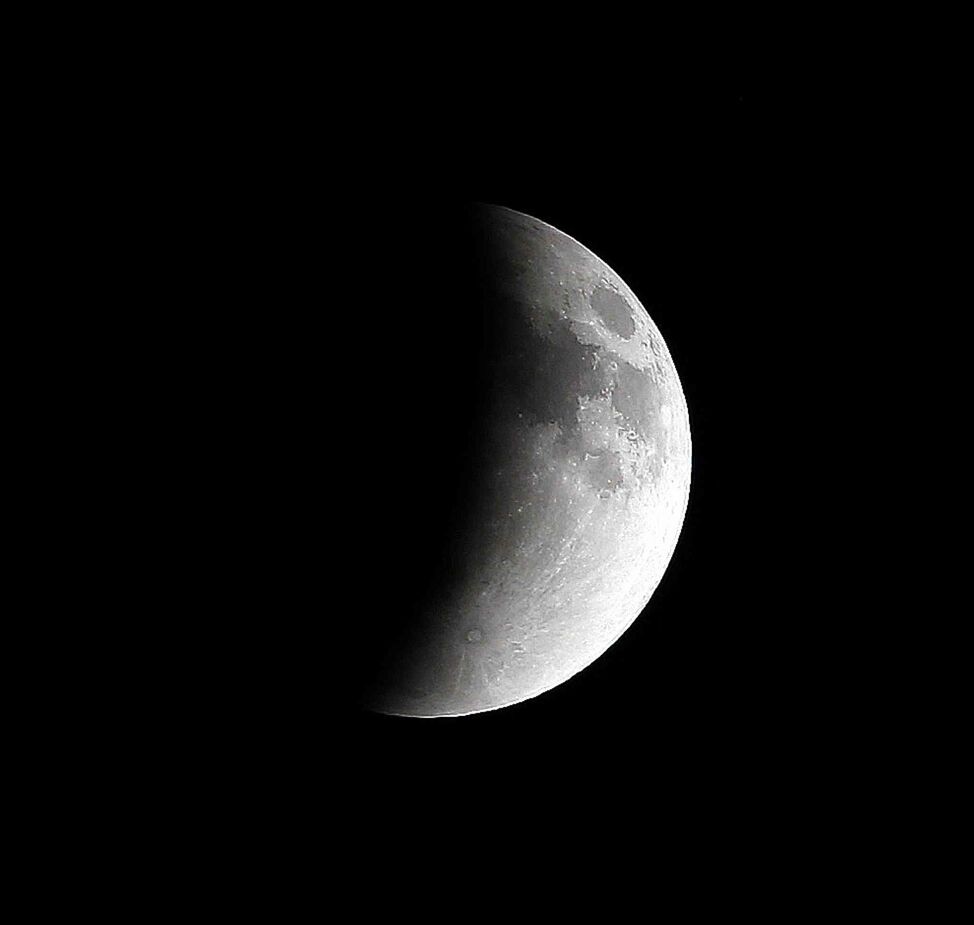 The moon was eclipsed by the Earth's shadow early Tuesday, beginning around midnight for 5-1/2 hours.