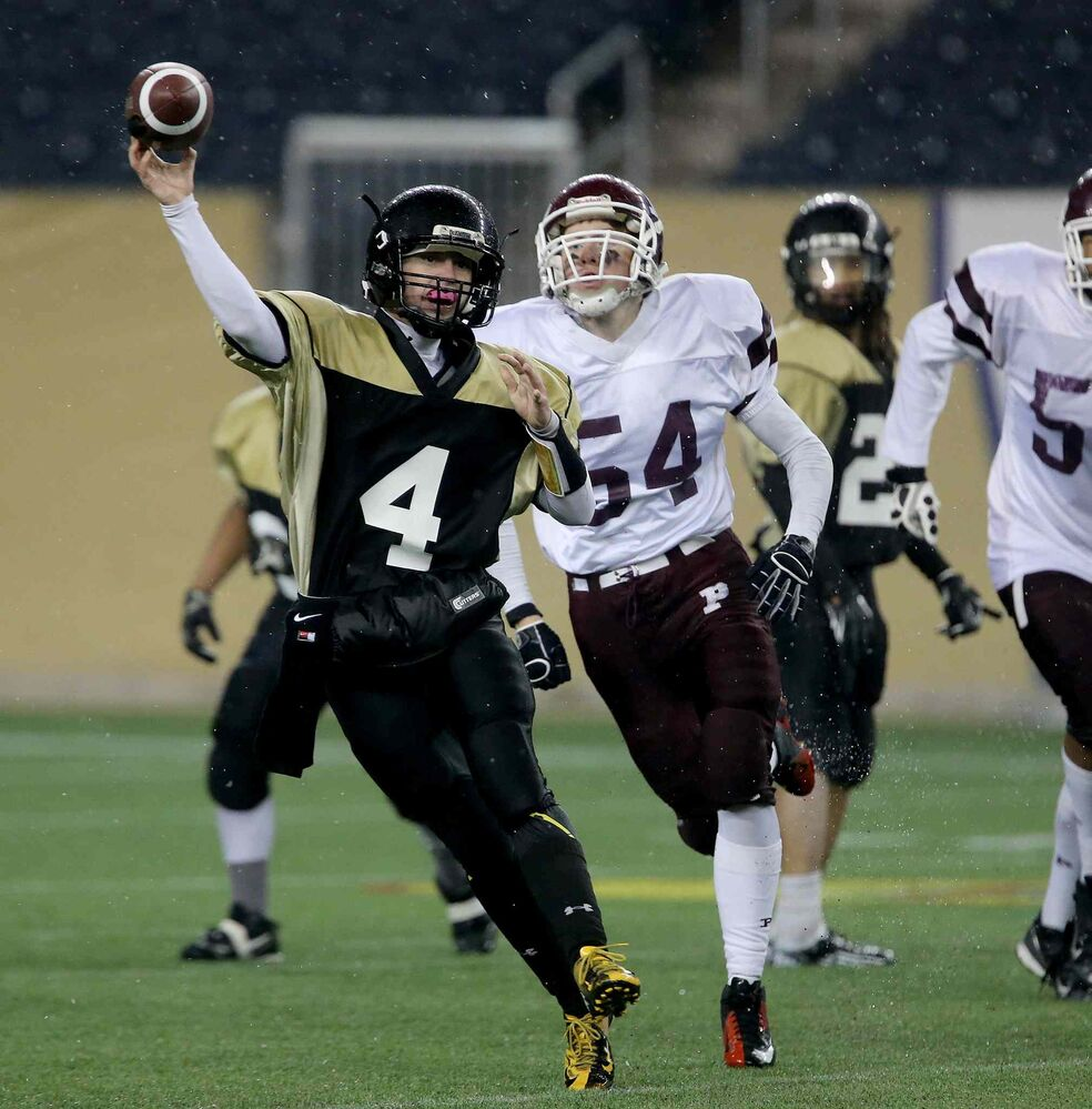 Garden City Gophers quarterback Justin Casper is chased by St.Paul's Crusaders Bradley Buckle during the second half. (Trevor Hagan / Winnipeg Free Press)