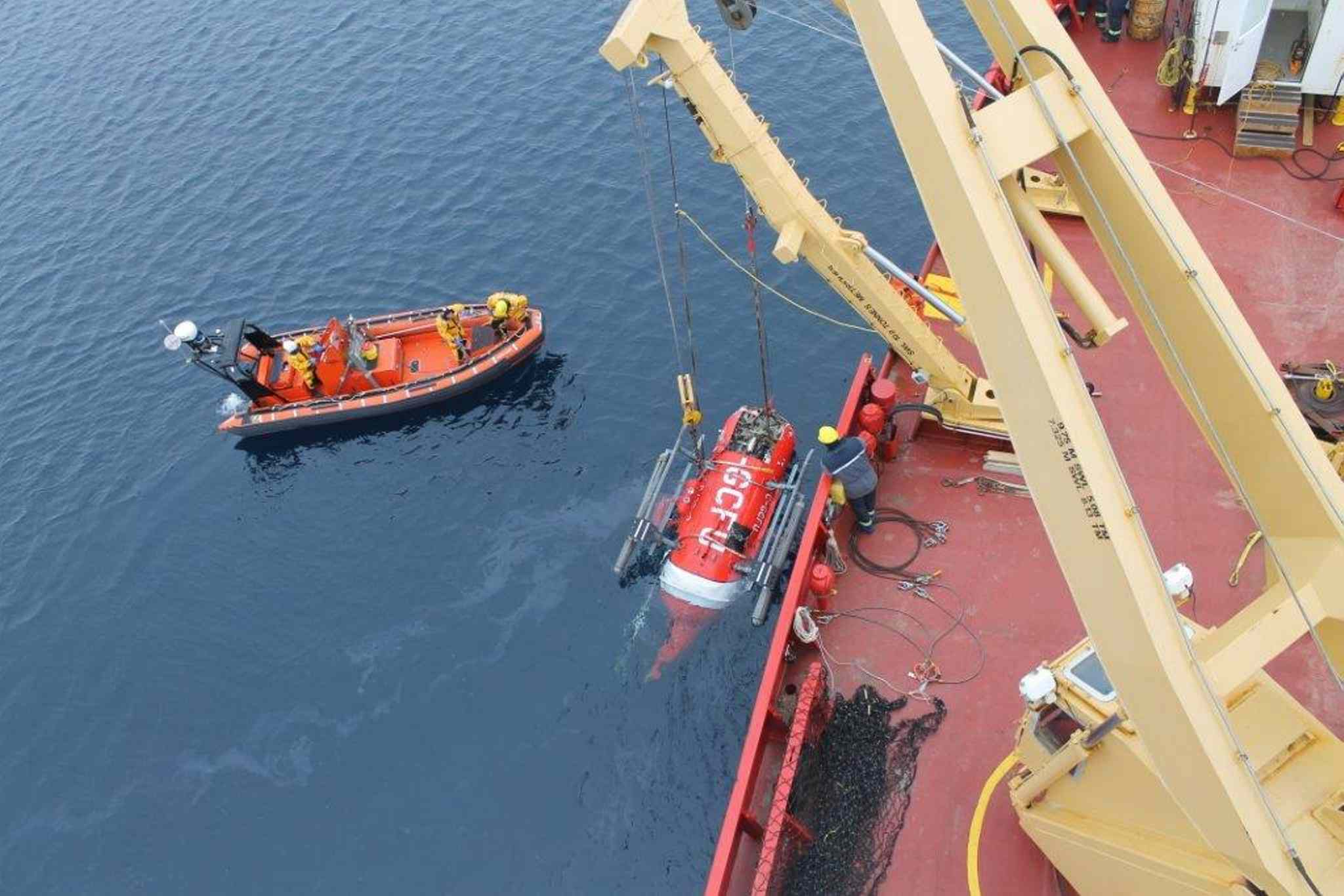Recovery operation of the sunken Canadian Coast Guard helicopter in the M'Clure Strait, Northwest Territories