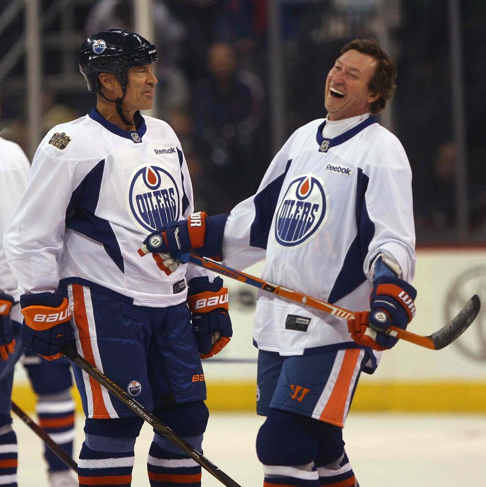 Edmonton Oilers alumni team member Wayne Gretzky laughs with Mark Messier during a team practice at the MTS Centre in preparation for the 2016 Heritage Classic game against the Winnipeg Jets. Oct. 21, 2016 -