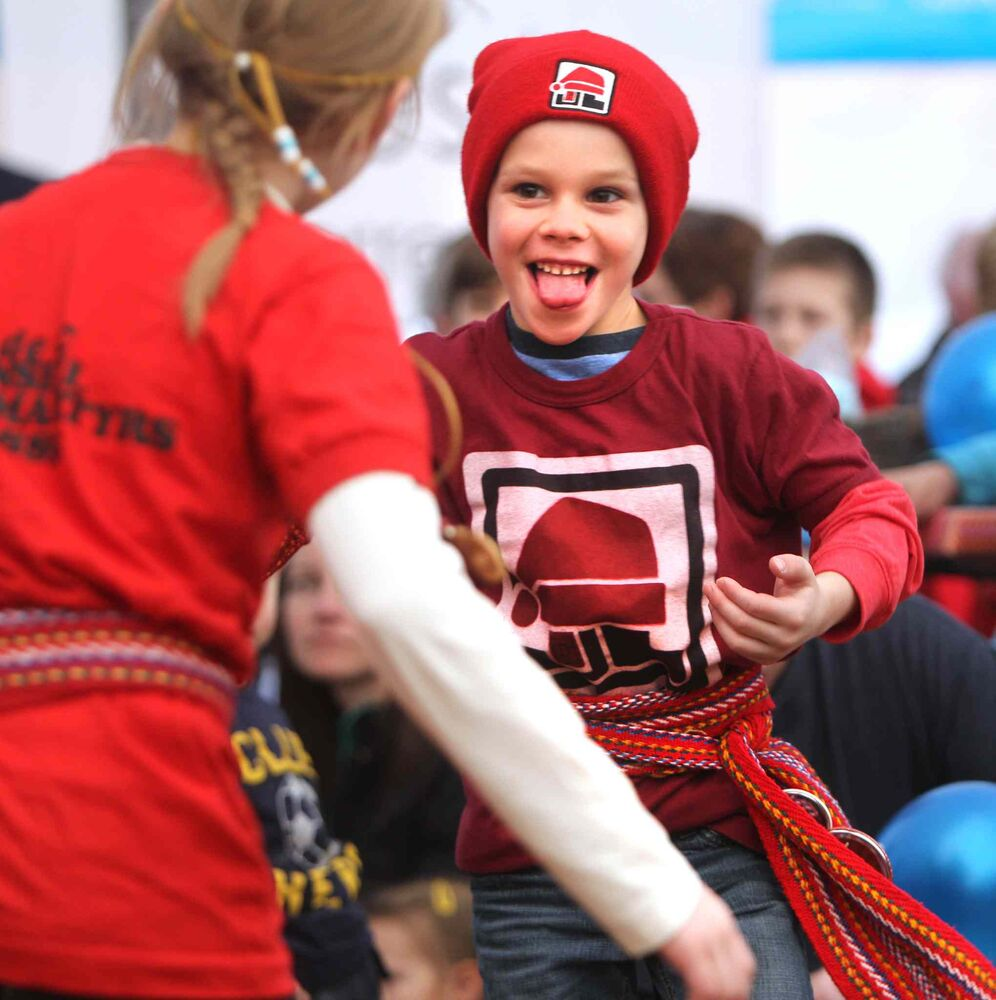 Six-year-old Caleb Arnaud dances with his sister Katherine to the music of The Bart House Band in the Sugar Shack at the 45th annual Festival du Voyageur Saturday afternoon. (Ruth Bonneville / Winnipeg Free Press)