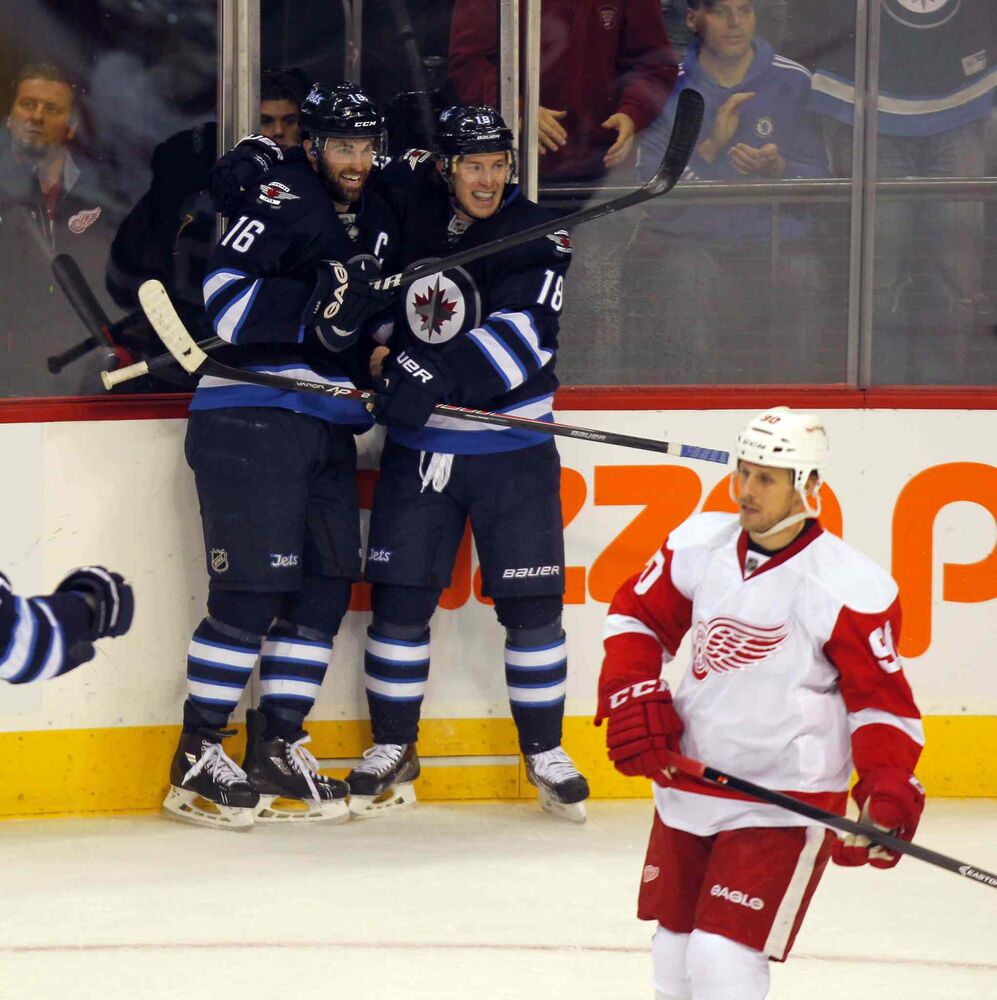 Winnipeg Jets forward Bryan Little celebrates with teammate Andrew Ladd after scoring on a breakaway against Detroit Red Wings goalie Jimmy Howard late in the first period of an NHL game at the MTS Centre in Winnipeg Monday night. (BORIS MINKEVICH / WINNIPEG FREE PRESS)