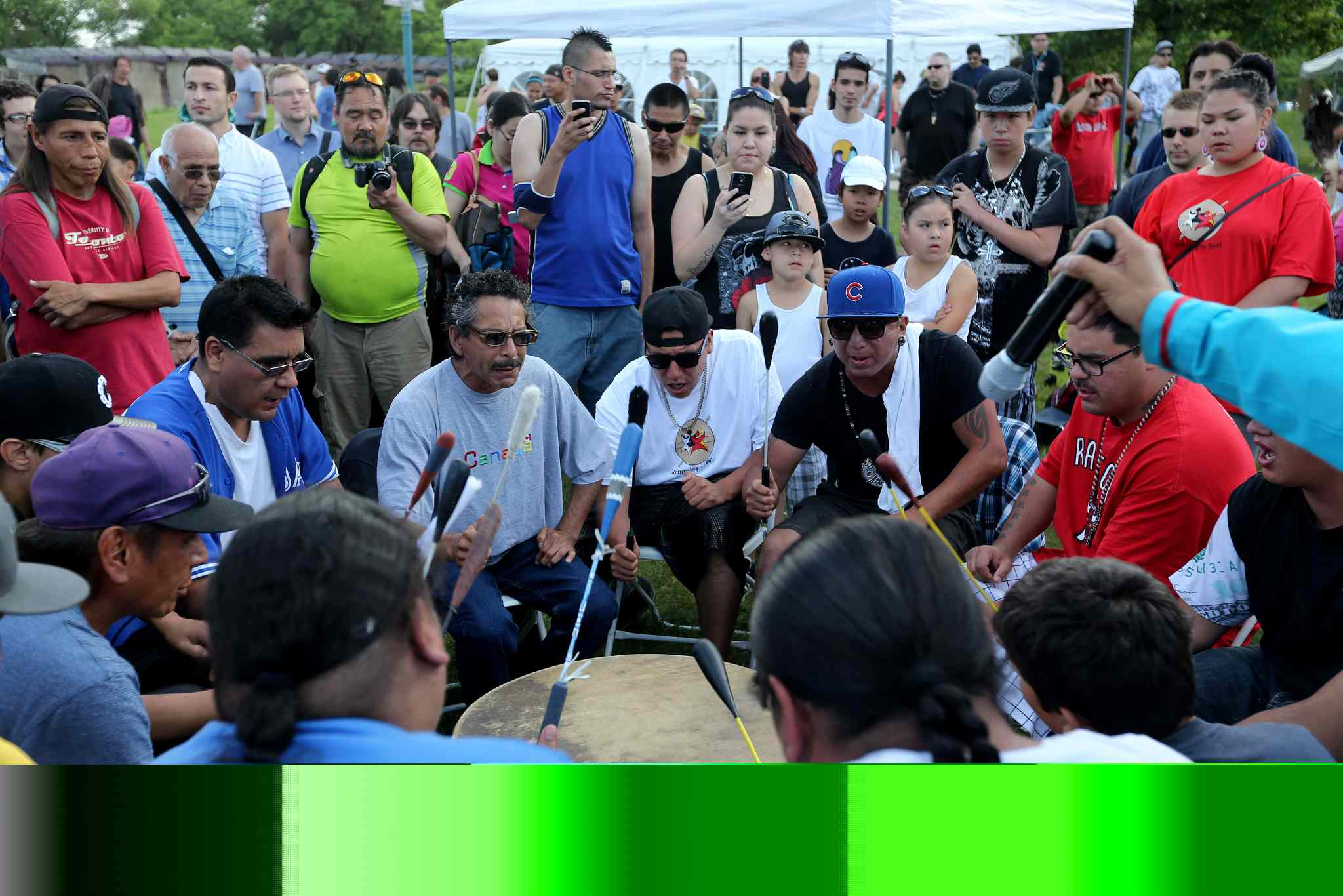 The Brown Bear Drum Group, made up of members from many communities, but all residing in St.Norbert, playing at The Forks, on Aboriginal Day, Saturday.