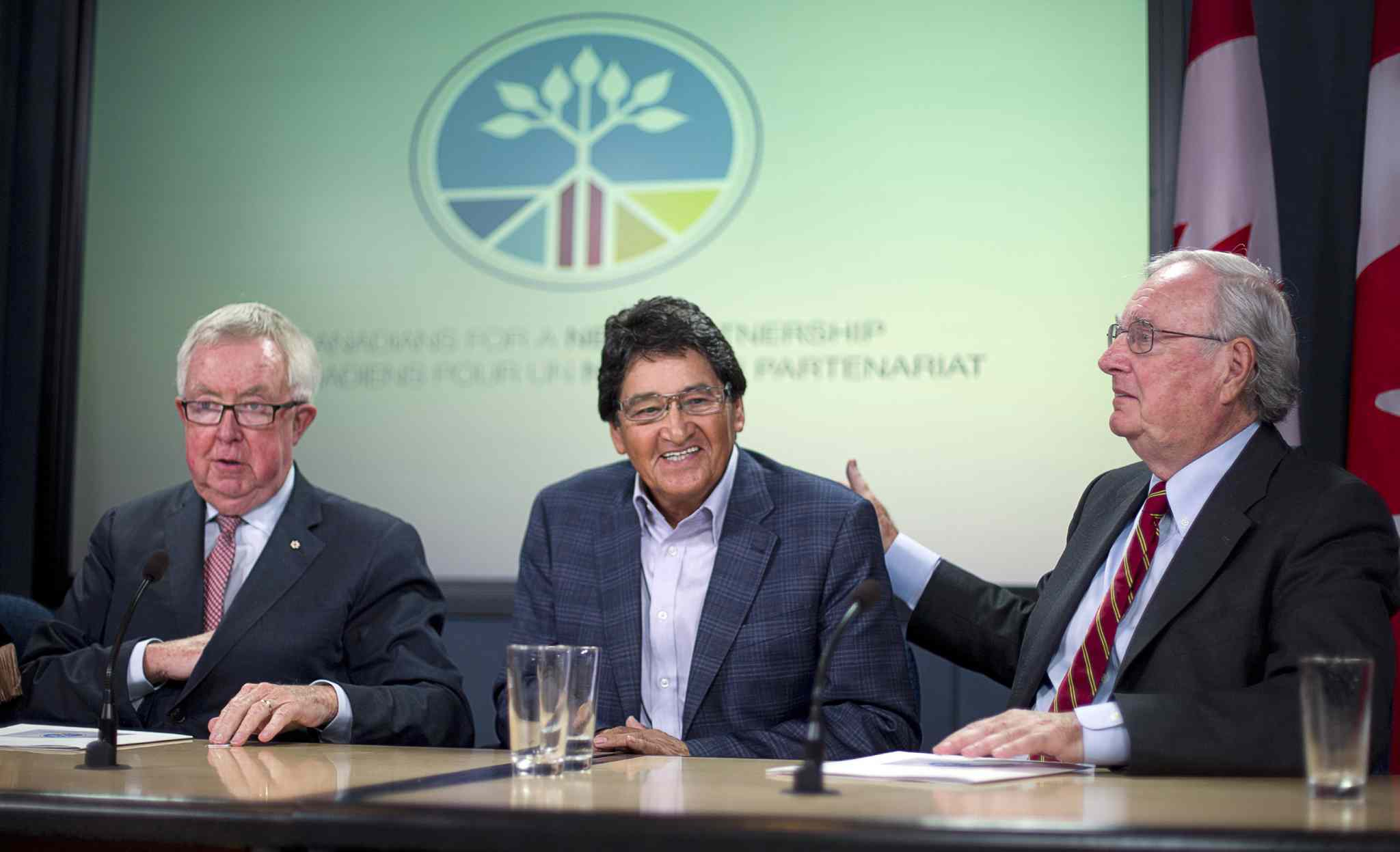 Former Prime Minister Joe Clark, former Assembly of First Nation Chief Ovide Mercredi and former Prime Minister Paul Martin (left to right) conclude a news conference in Ottawa Thursday, Sept. 4, 2014. The former prime ministers and aboriginal leaders are joining forces in a bid to ease tensions between aboriginal and non-aboriginal groups.
