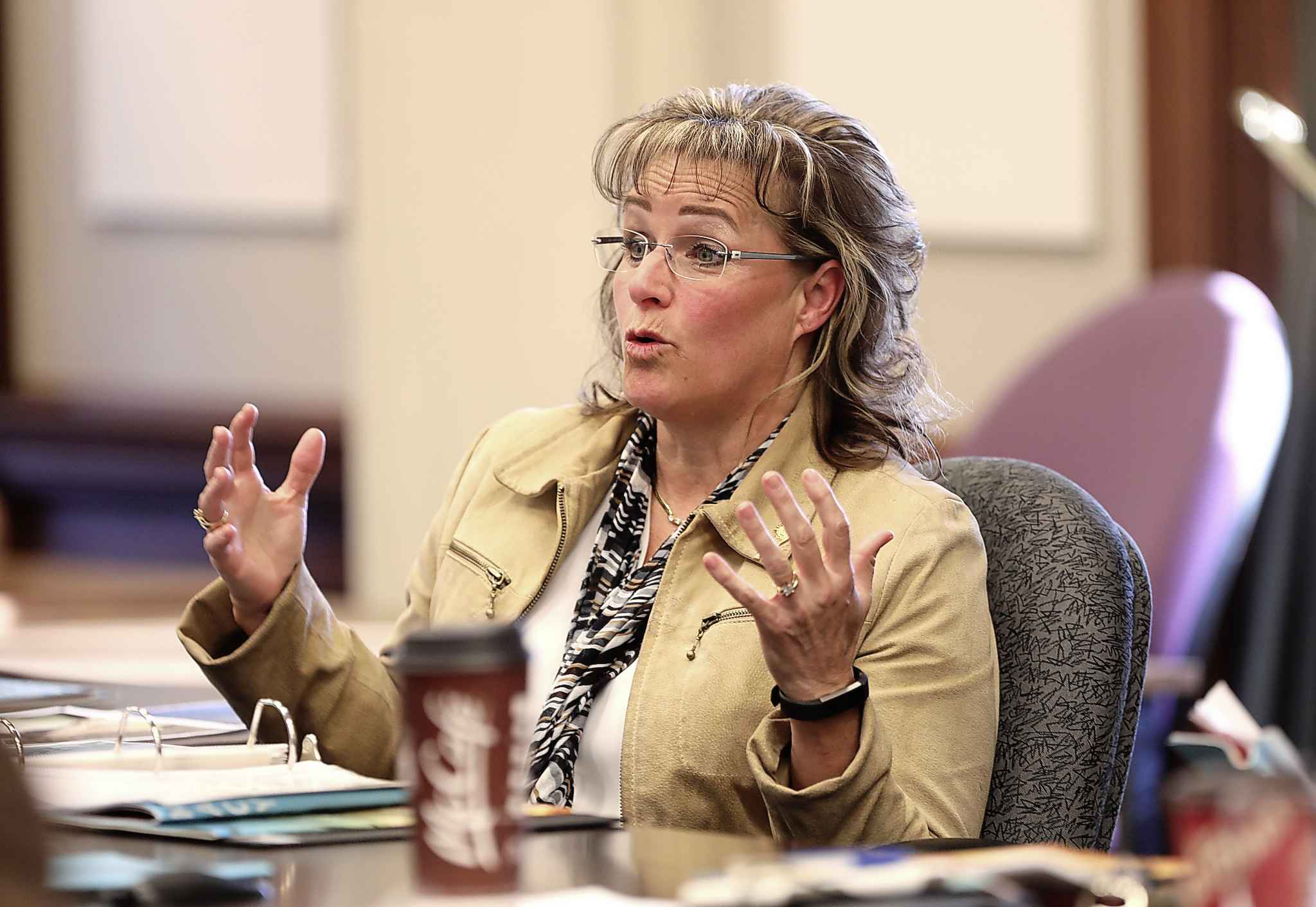 Manitoba's Advocate for Children and Youth, Daphne Penrose, answers questions about her annual report from members of the legislative assembly at the Legislative Building, Wednesday.