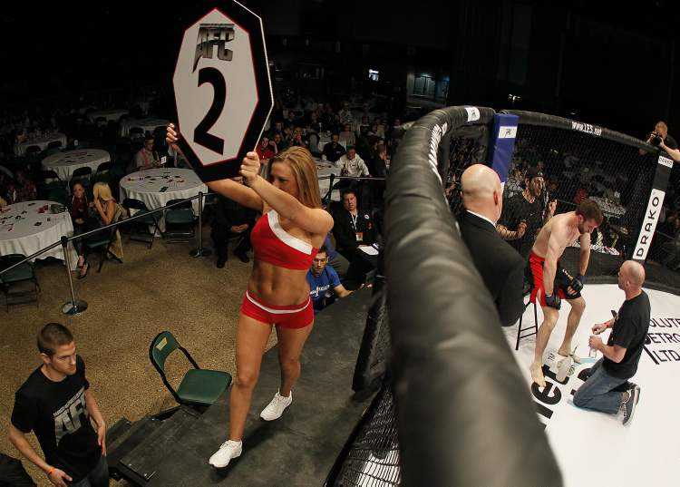 Round 2 is announced as Mitch Fryia gets attention from his coach during his fight with Dwight Sutherland in the Aggression Fighting Championships mixed martial arts competition at the Winnipeg Convention Centre.  John Woods / Winnipeg Free Press