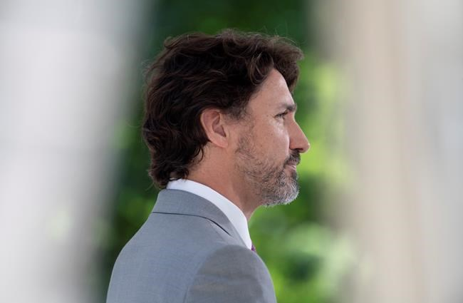 Prime Minister Justin Trudeau listens to a question during a news conference outside Rideau Cottage in Ottawa, Monday, June 29, 2020. THE CANADIAN PRESS/Adrian Wyld